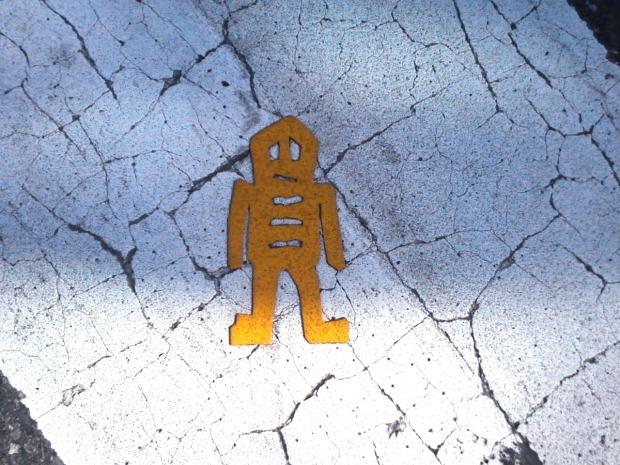 yellow stikman in crosswalk