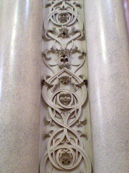Norman grotesque faces column