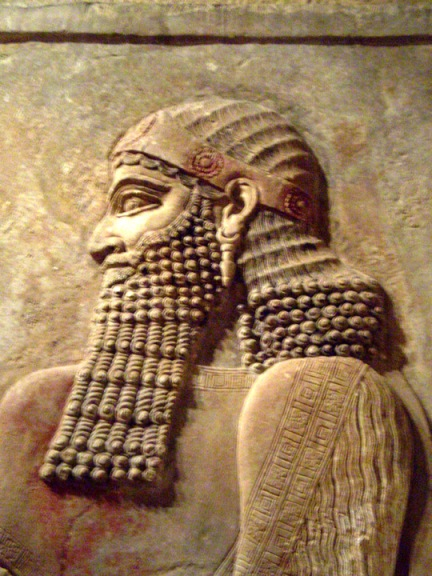 Proper Assyrian royal man with beard and rose head band.
