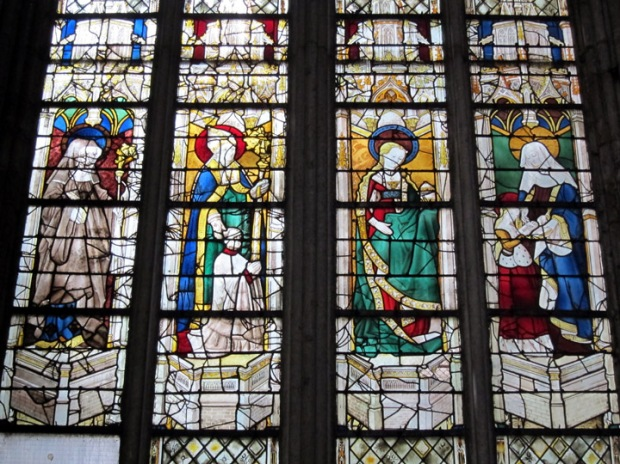 16th century stained glass windows of four saints