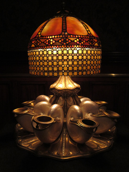 Tiffany glass lamp with a nautilus shell base.