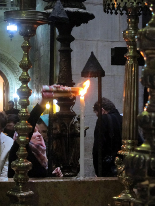 Orthodox pilgrim lighting candles