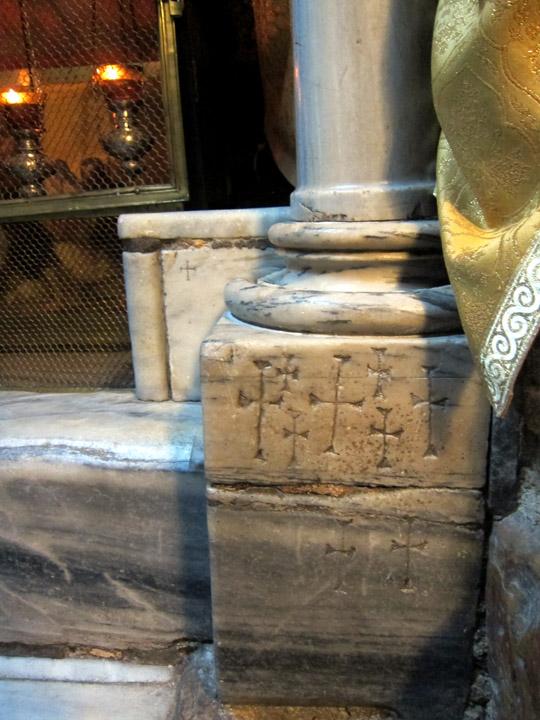 Cross graffiti beside the Chapel of the Manger