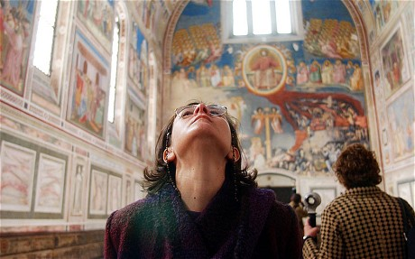 A woman (i.e. not me) looks at the Giotto frescoes at the Scrovegni chapel, in Padua, northern Italy  Photo: AP via The Telegaph)