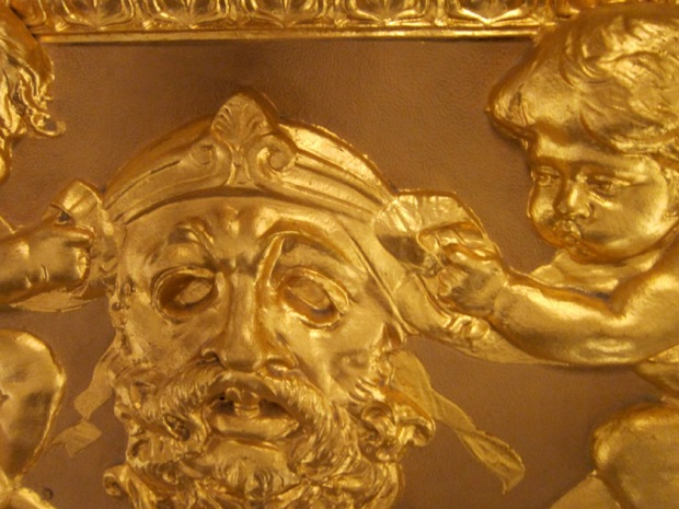 mask and cherub detail