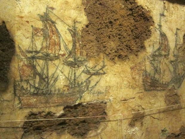 Tail ship graffiti on a prison wall